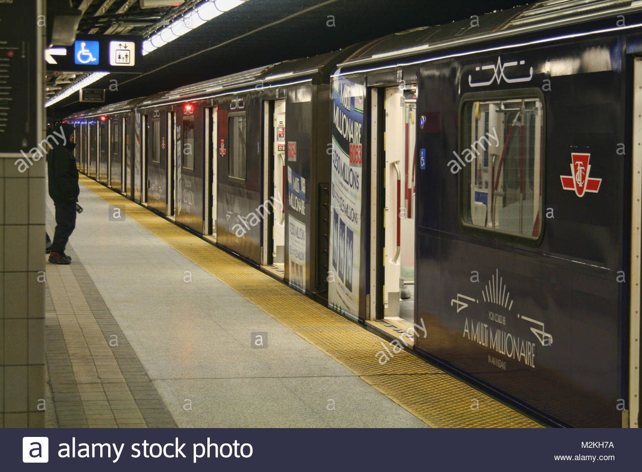 Man stands outside a subway train at Finch Subway Station in Toronto, Ontario, Canada, on February 5, 2018. - Stock Image