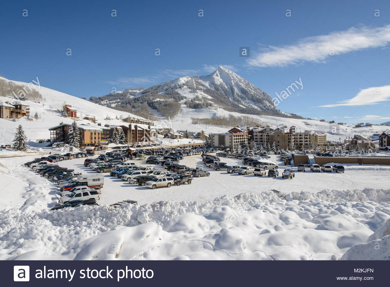 Crested Butte Mountain ski area from the base area parking lot on a perfect winter day. Stock Photo