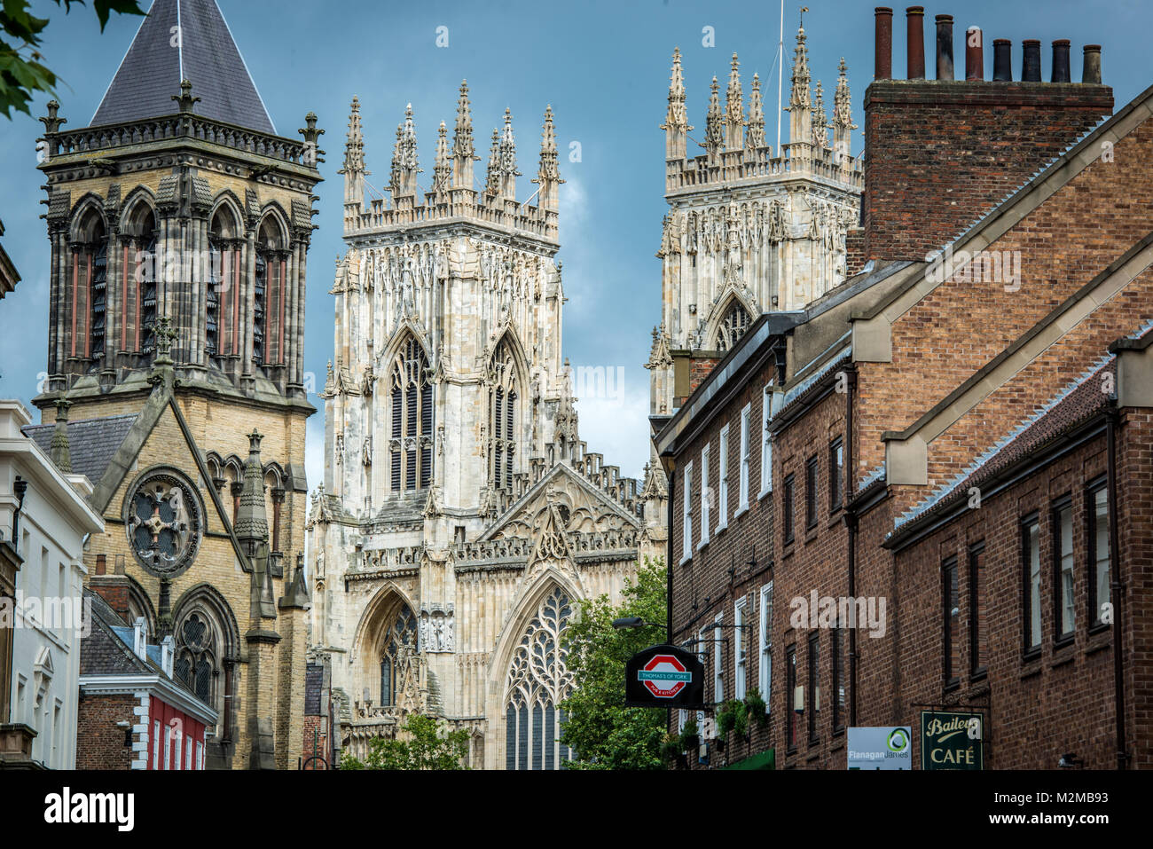 Positioned centrally the cathedral of York Minster soars into the skies over the City of York, Yorkshire, United Stock Photo