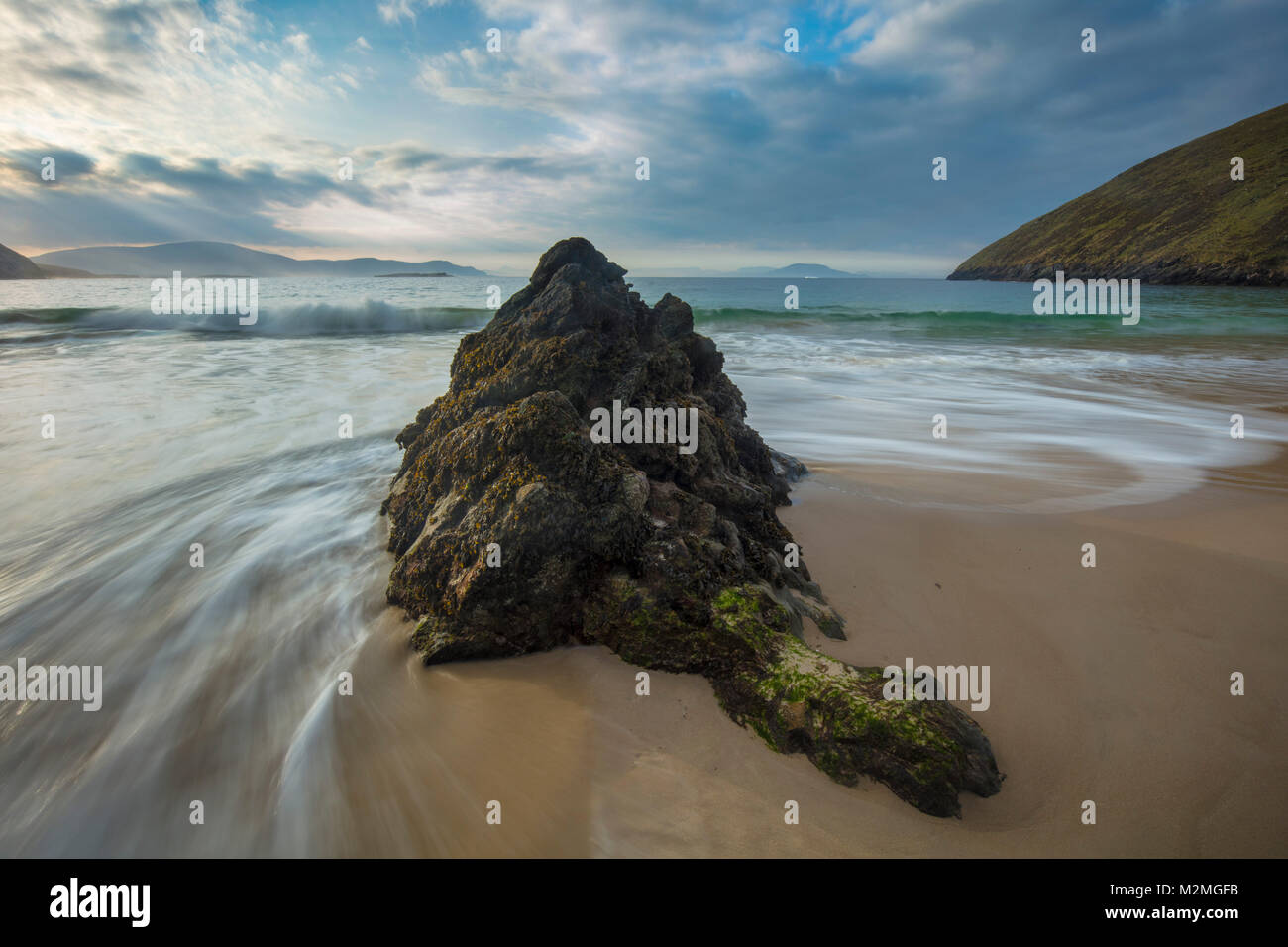 Waves and boulder on Keem Beach, Achill Island, County Mayo, Ireland. Stock Photo