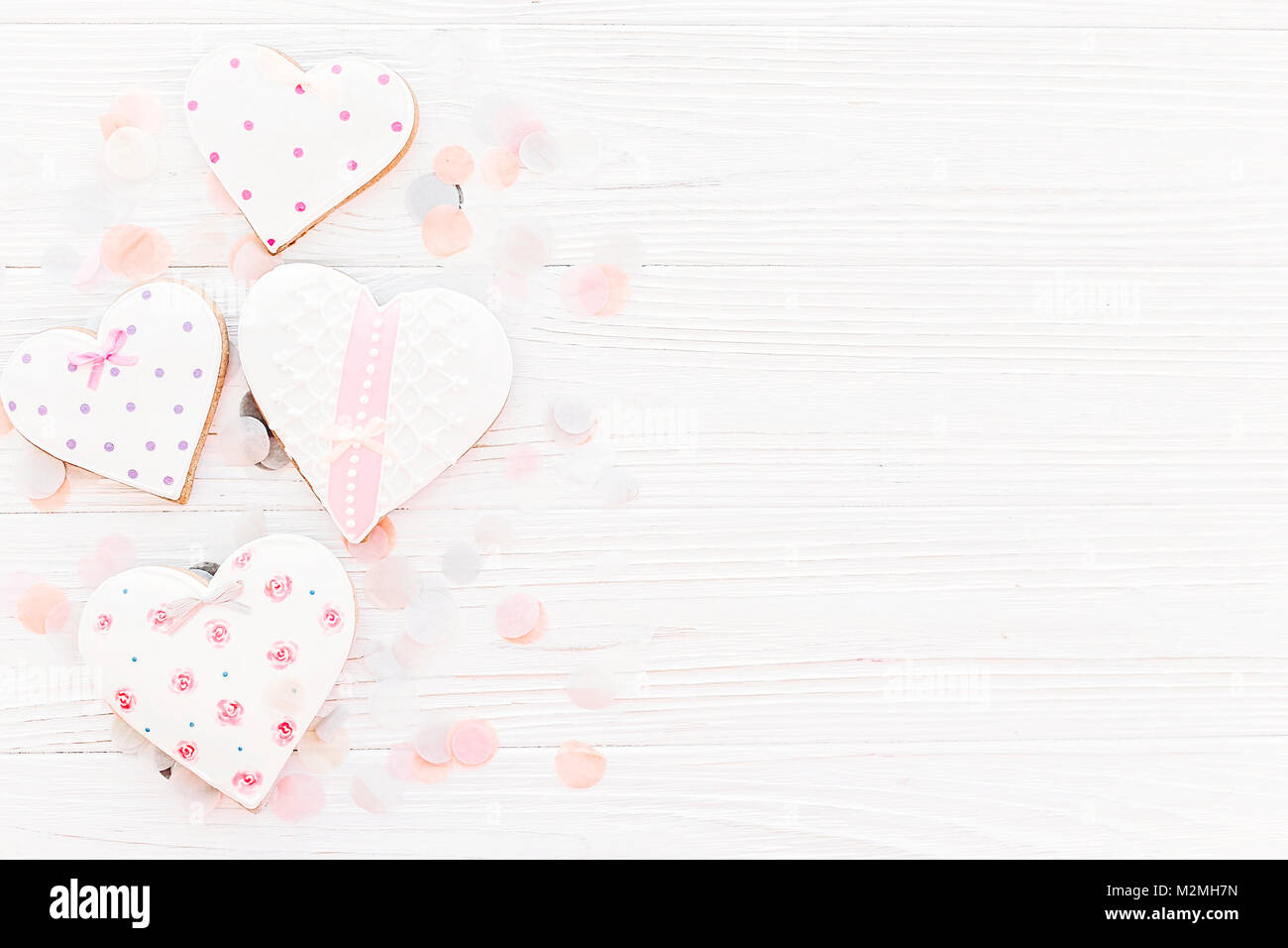 Pink Cookie Hearts On White Rustic Wooden Background With Confetti Flat Lay In Soft Light Happy Valentines Day Mothers Womens Greeting