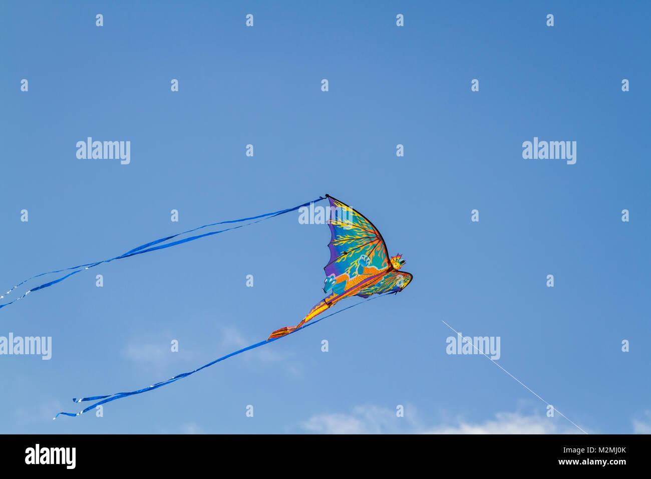 Dragon kite flying in the sky - Stock Image