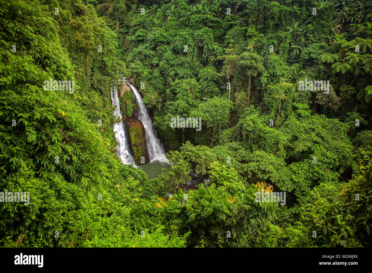 Kipot Twin Waterfalls near Bago City in the mountains of Negros Occidental Island in the Philippines is an unusual - Stock Image