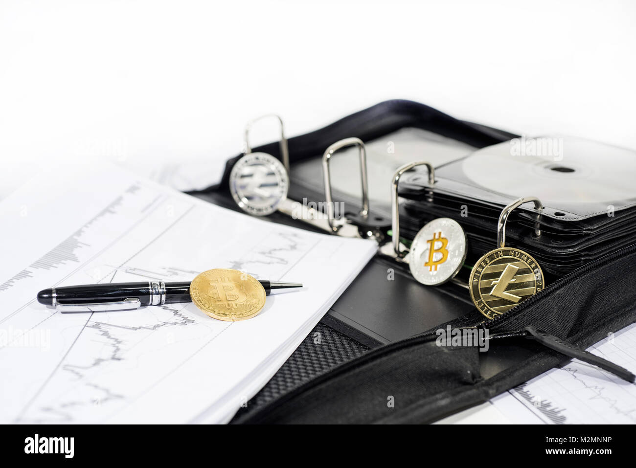 Abstract cryptocurrency photo. Some crypto coins on documents. Stock Photo