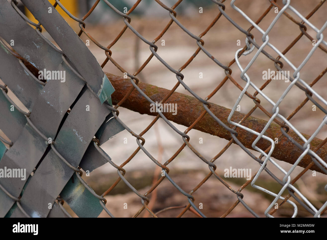 Rusty Chain Link Fence With A Brown And Grey Urban Background Blurred Stock Photo Alamy