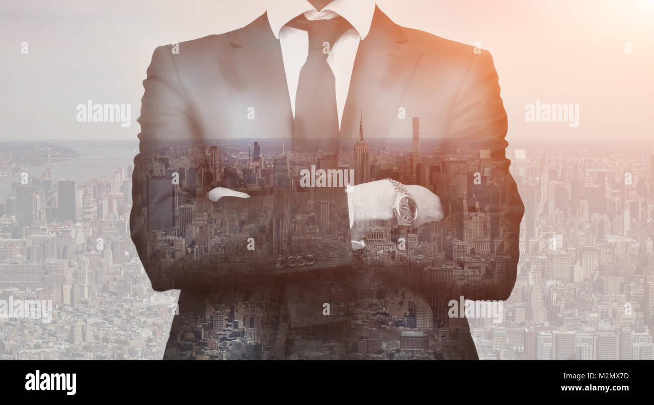 Double exposure of success business man with arms crossed and city in background. Concept businessman lifestyle Stock Photo