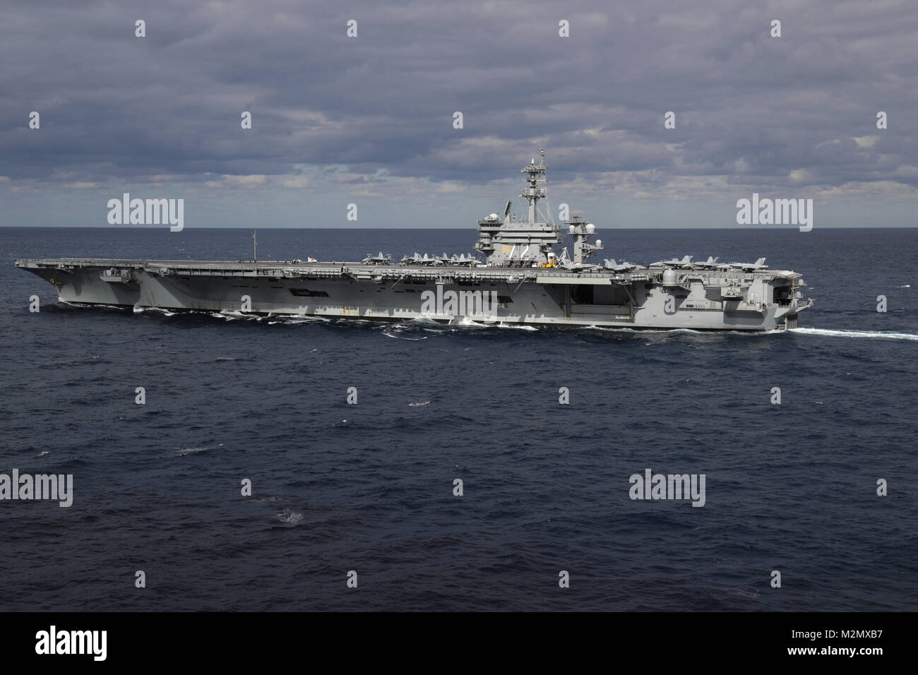 180201-N-PW716-0112 ATLANTIC OCEAN (Feb. 1, 2018) The Nimitz-class aircraft carrier USS Abraham Lincoln (CVN 72) - Stock Image