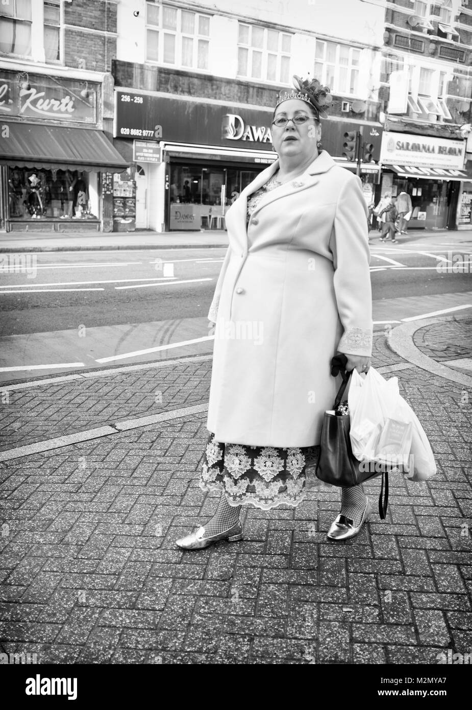 Black & White Photograph of a woman shopping in Tooting High Street, London, England. UK, Credit: London Snapper - Stock Image