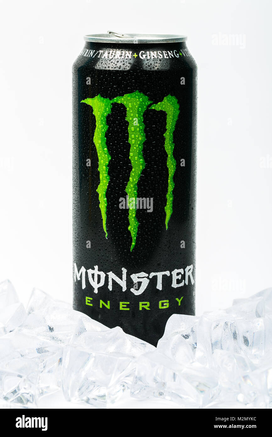 Trieste, Italy - August 19, 2016: A can of Monster Energy Drink with ice. Introduced in 2002 Monster now has over - Stock Image