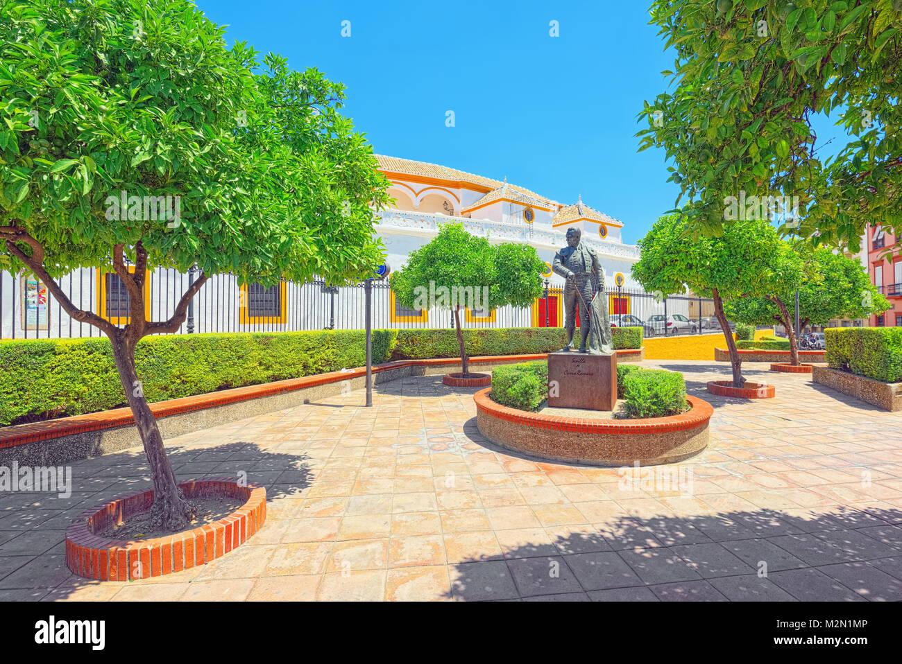 Sculpture near Arena on of Square of bulls Royal Maestranza of Cavalry in Seville.(Plaza de toros de la Real Maestranza - Stock Image