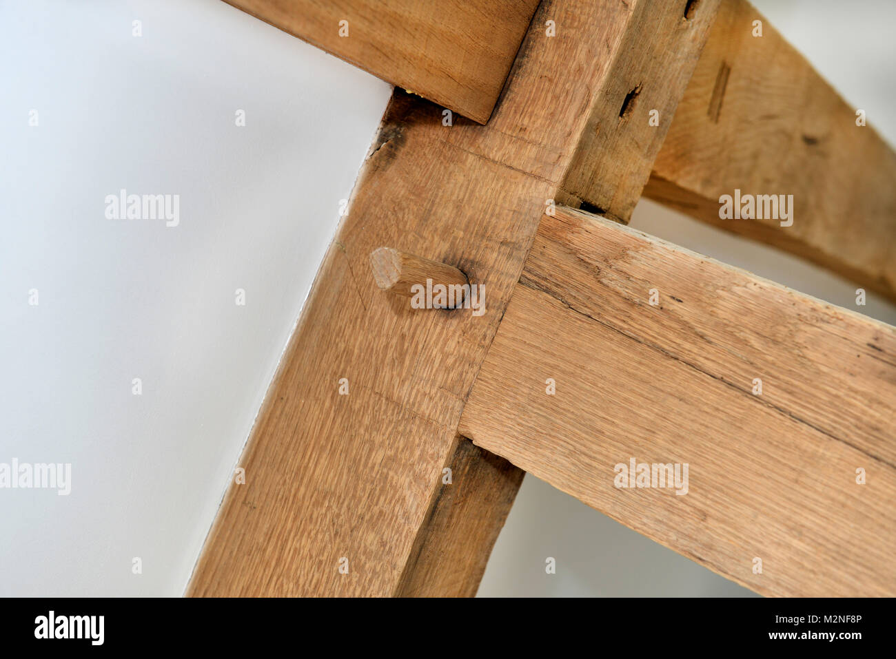 a detail of a wooden pin joint in building rafter - Stock Image