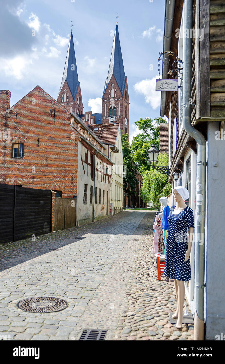 Neuruppin, Germany - 28 August, 2017: Street Siechenstrasse with atelier and Holy Trinity Church in an old town - Stock Image
