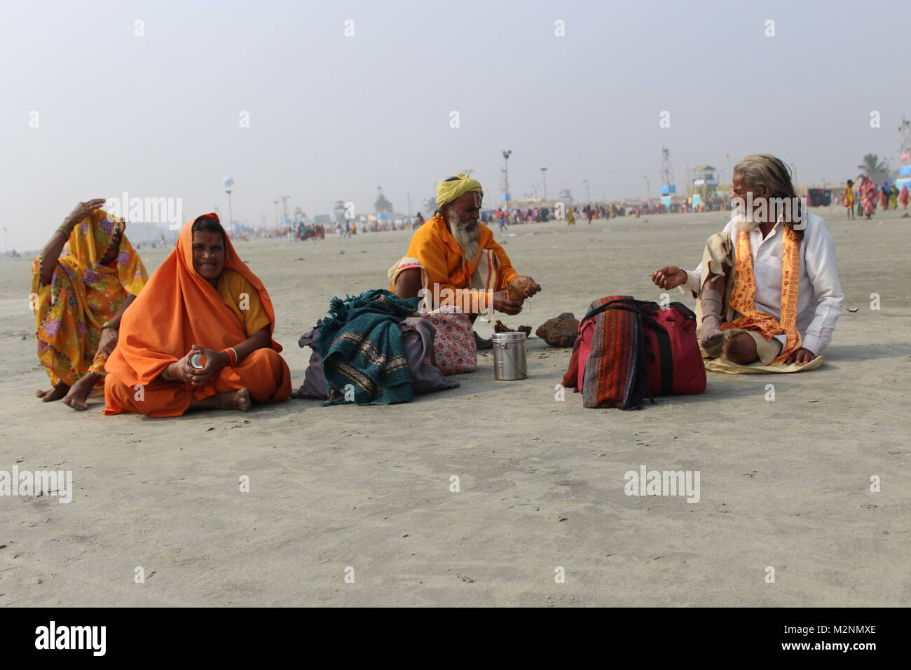 A Group of Pilgrims Take A Rest At Beach - Stock Image