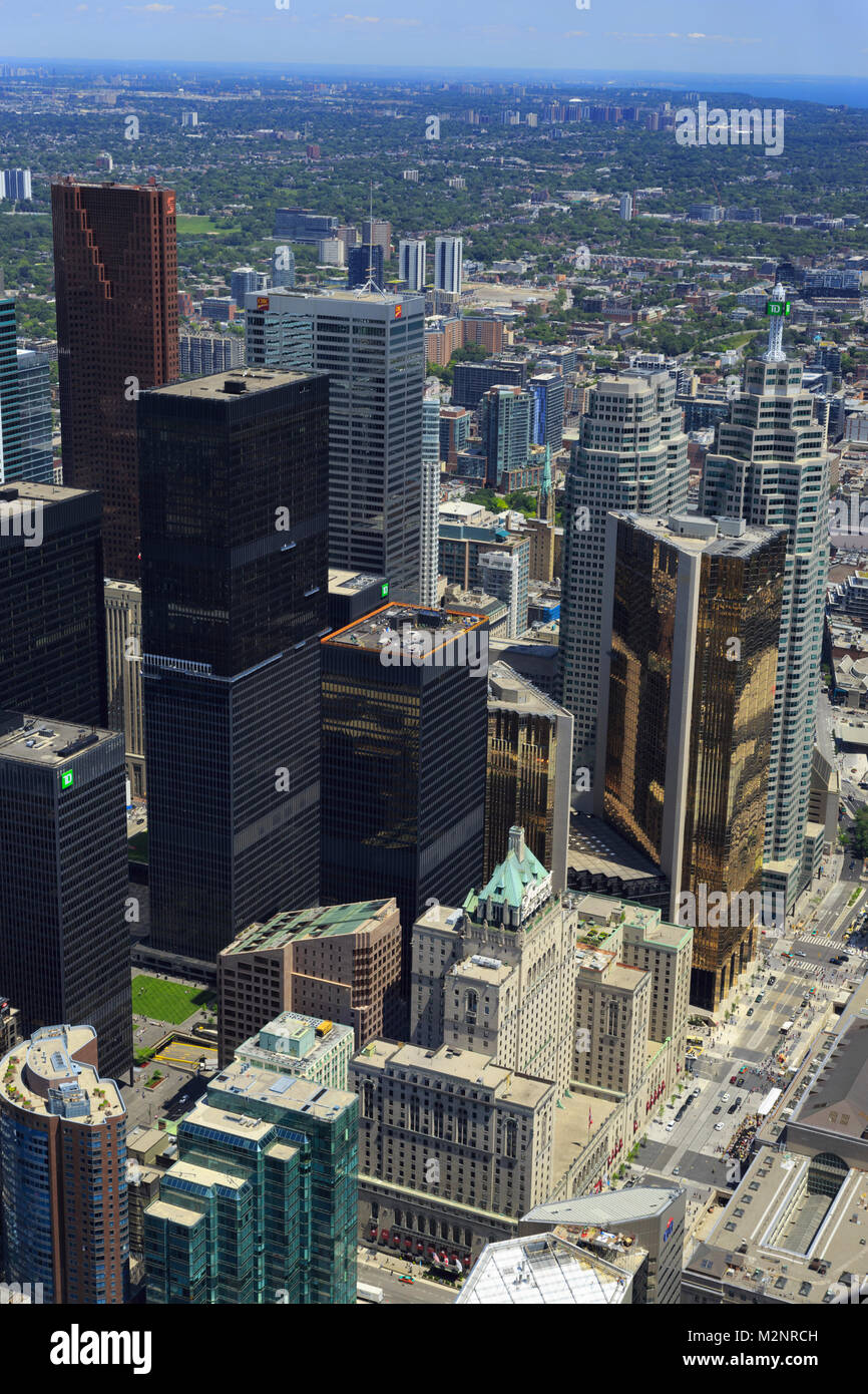 Aerial rooftop view of downtown Toronto Ontario Canada from the CN tower, mirrored glass skyscrapers busy streets - Stock Image