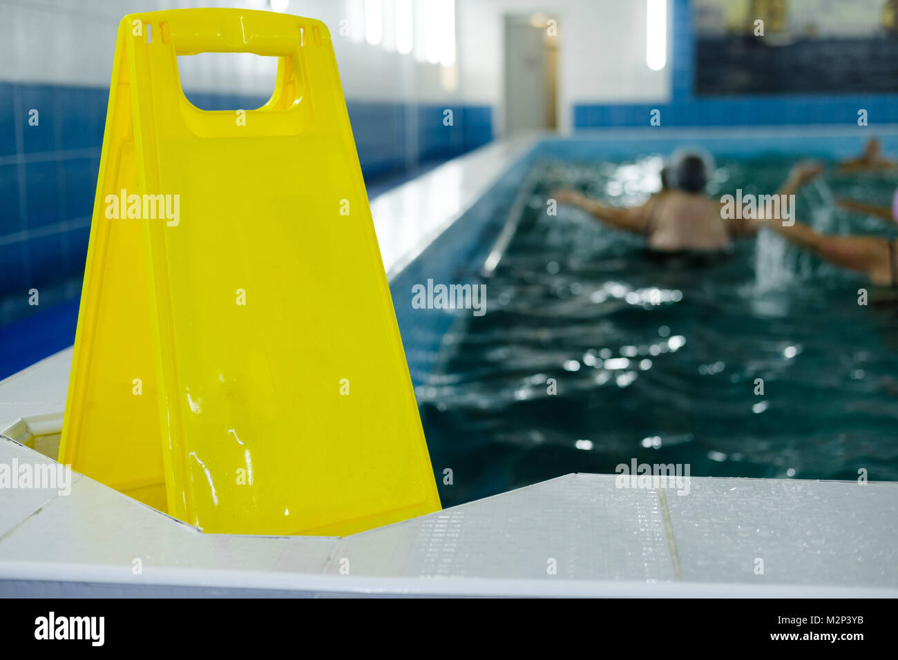 Yellow plastic sign by swimming pool. Copy space. Empty space for text. Pool in nursing home - Stock Image