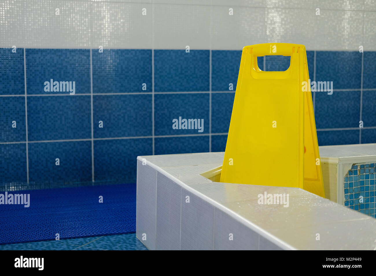 Yellow plastic sign by swimming pool. Copy space. Empty space for text. - Stock Image