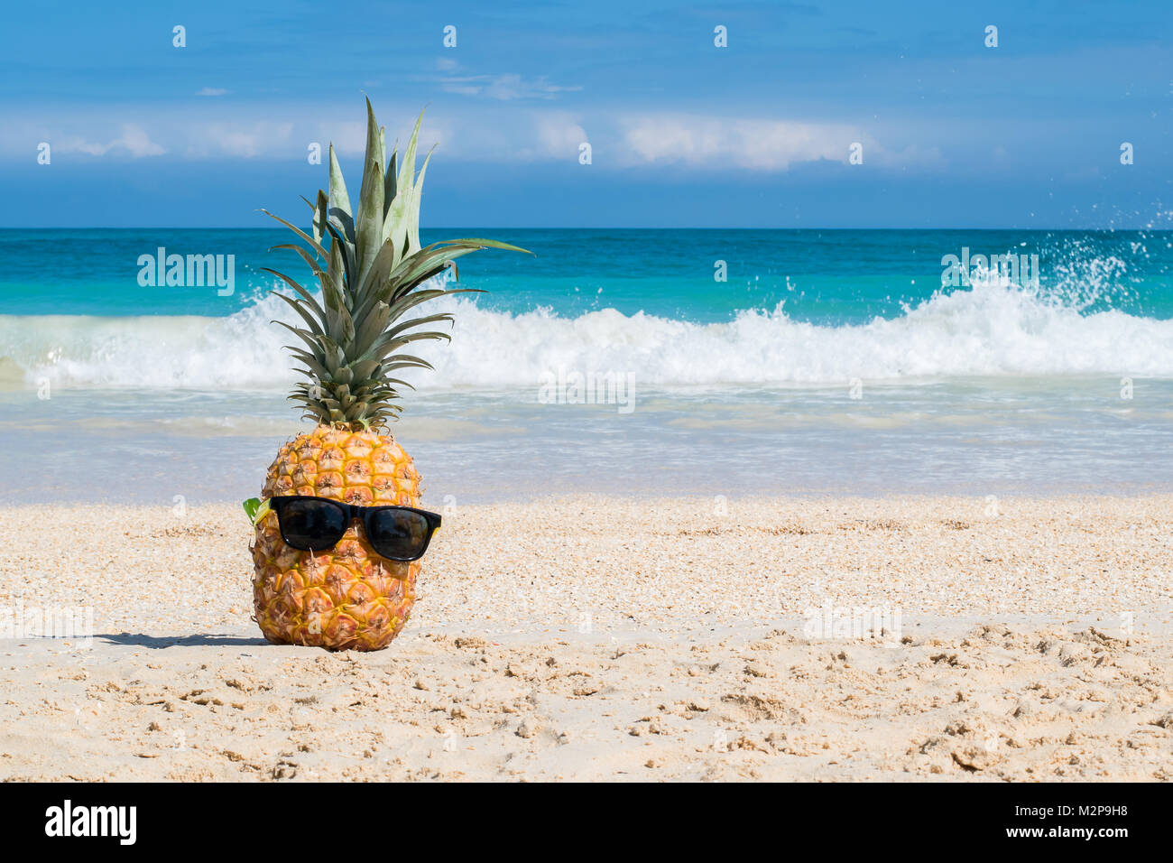 Hey girl, You a Fine-apple: Tropical pineapple chillin on a beach with sunglasses representing hawaiian vacation concept Stock Photo