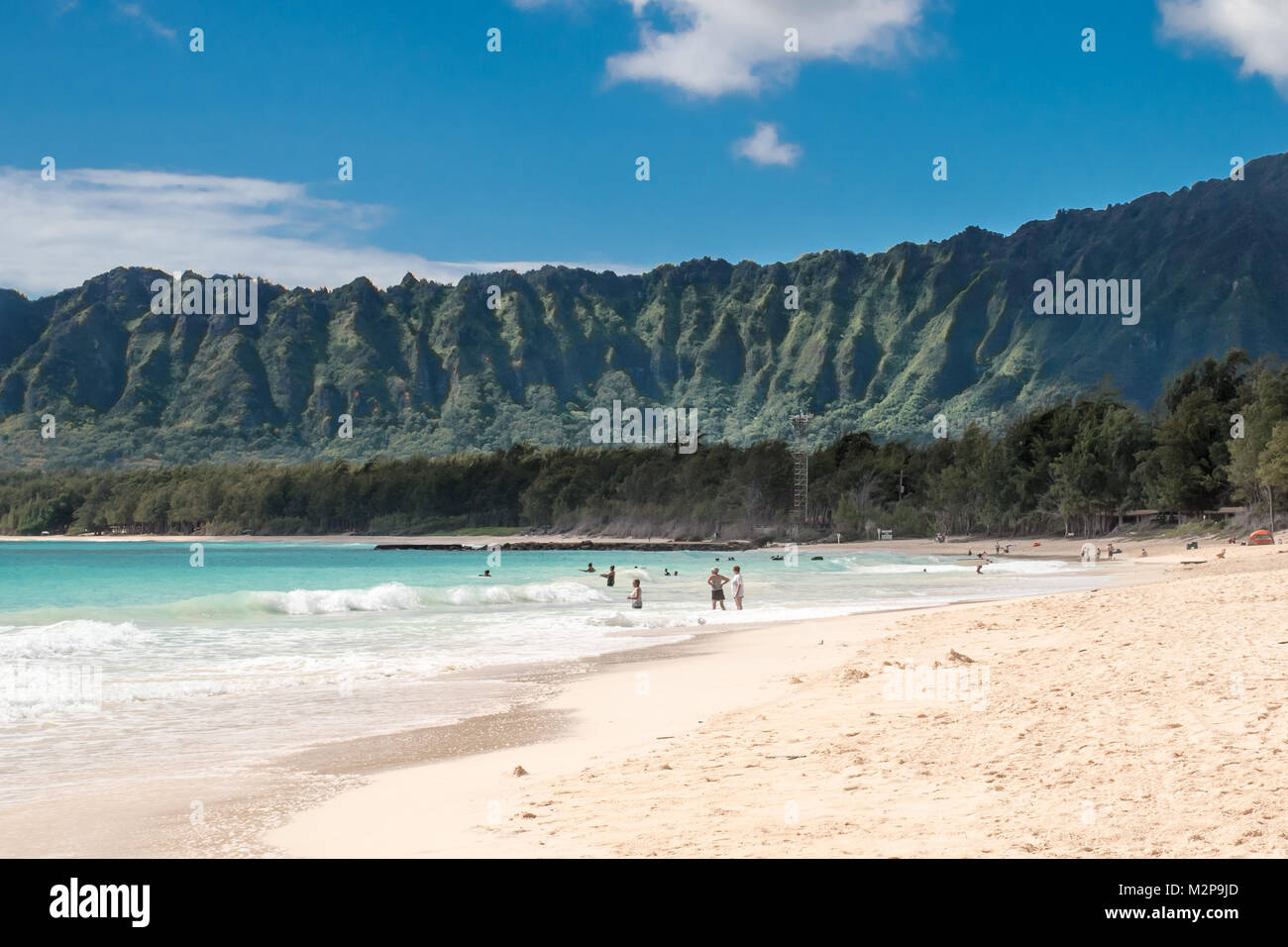 Bellows Beach Morning, Oahu Hawaiian Islands, with sunshine, sky, mountains and clouds - Stock Image