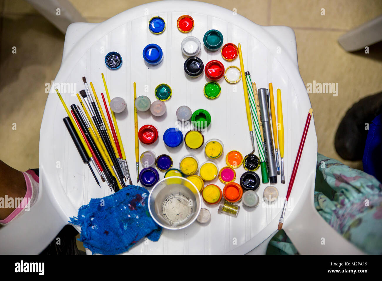 Remarkable Chair With Many Colourful Paint Utensils For Kids Play Seen Pdpeps Interior Chair Design Pdpepsorg