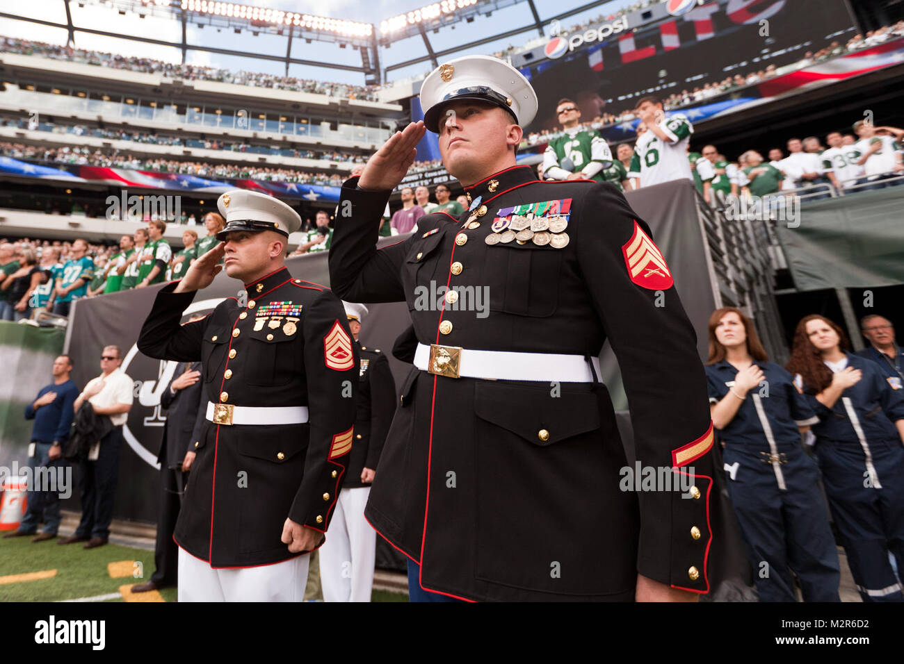 EAST RUTHERFORD, N.J. --  Sgt. Dakota Meyer, stands on the field while his Medal of Honor citation is read during - Stock Image