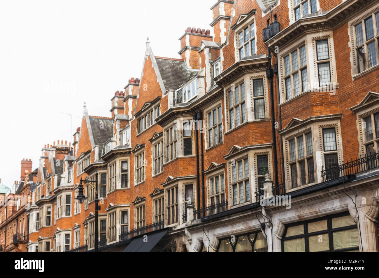 Hassade close bay windows and constructions of a London town house - Stock Image