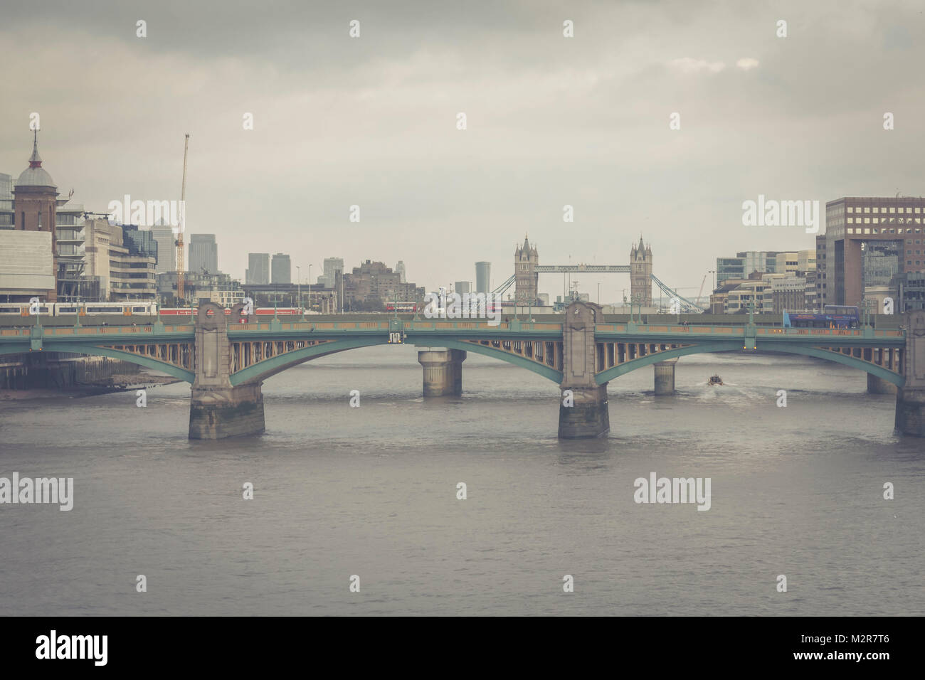 Southwark Bridge and in the background the Tower Bridge, - Stock Image