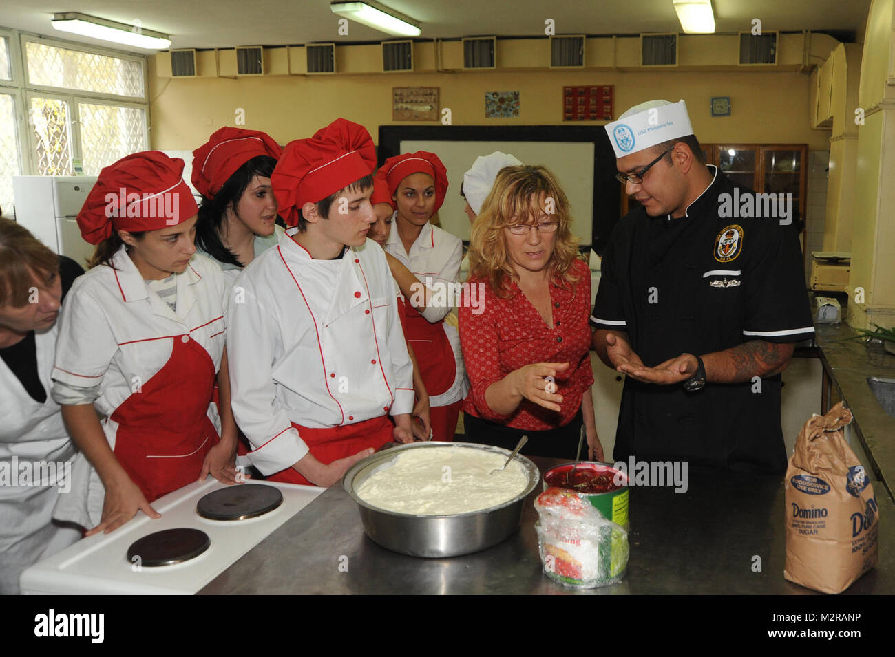 111026-N-RB564-028: BURGAS, Bulgaria (Oct. 26, 2011) - Culinary Specialist 2nd Class Eber Barraza explains to Bulgarian - Stock Image