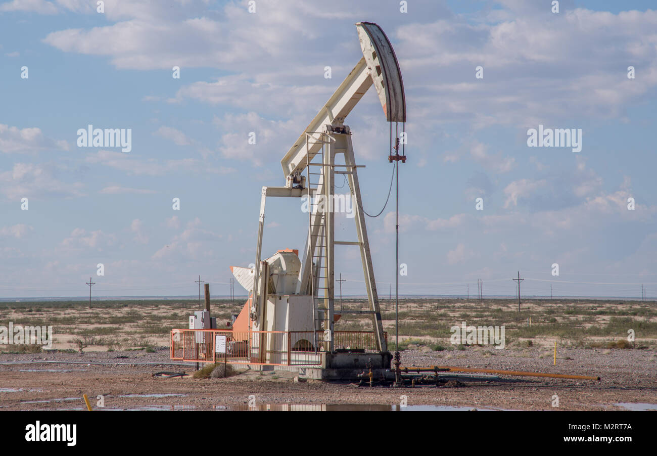 pump jack at west texas oil well - stock image