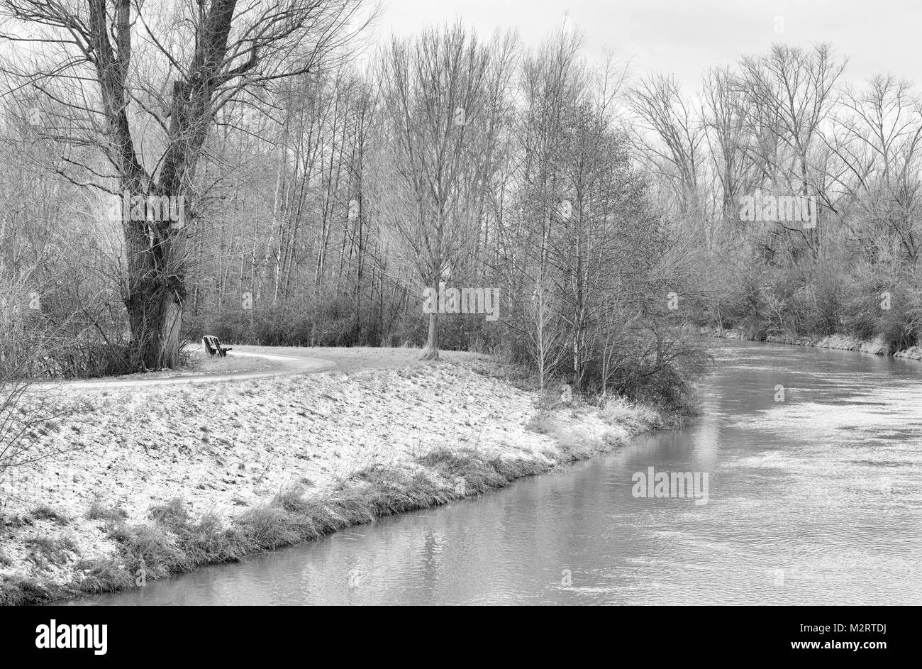 Monochrome nature landscape image of a rural autumnal / fall / winter countryside idyllic river morning scene,promenade, - Stock Image