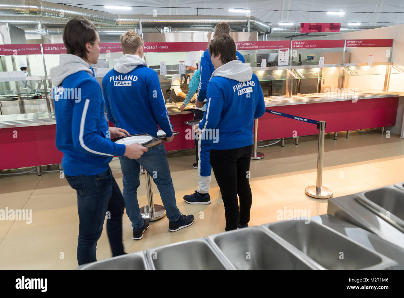Gangneung, South Korea. 08th Feb, 2018. Athletes from Finland arriving to the mess hall for a meal in the Olympic - Stock Image
