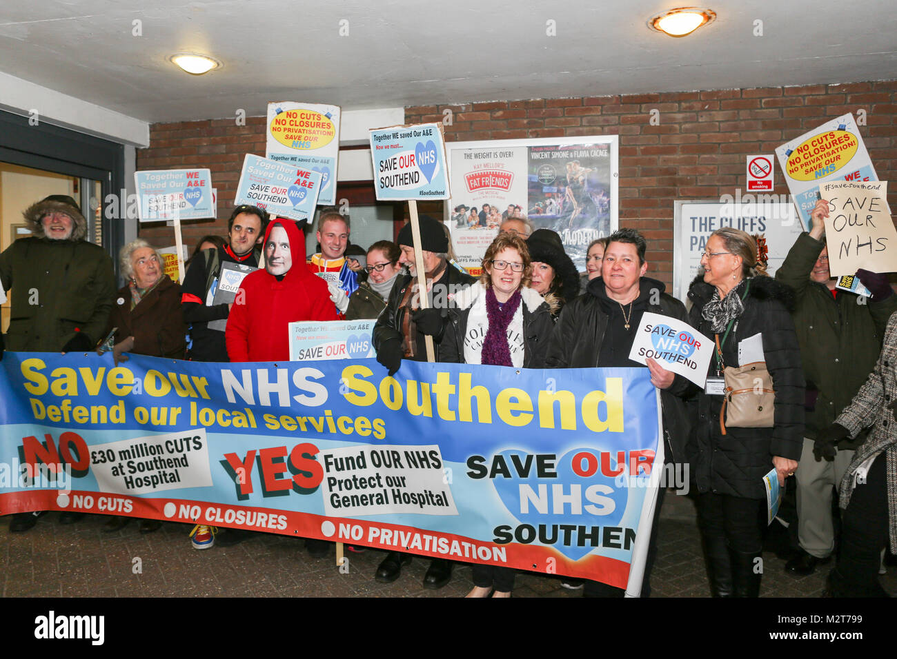 Southend-on-Sea, Essex, UK. 8th Feb, 2018. A small demonstration took place outside the Cliffs Pavilion to protest at the proposed merger of three local hospitals, Southend, Basildon and Broomfield before the public meeting. At the same time The Sustainability and Transformation Partnership (STP) are holding a public meeting to present the proposed changes. Penelope Barritt/Alamy Live News Stock Photo