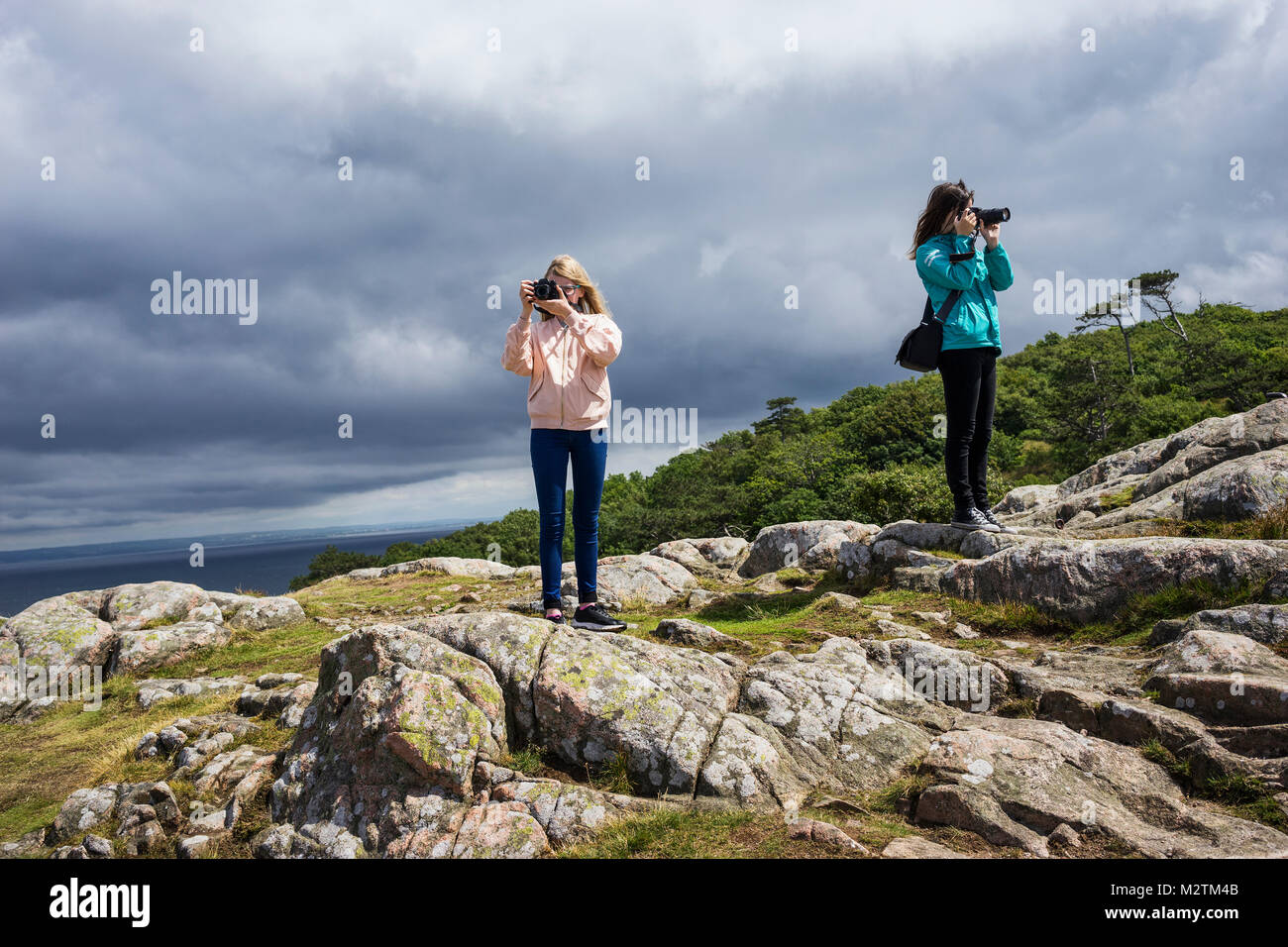 Two women taking photos in rural Sweden - Stock Image