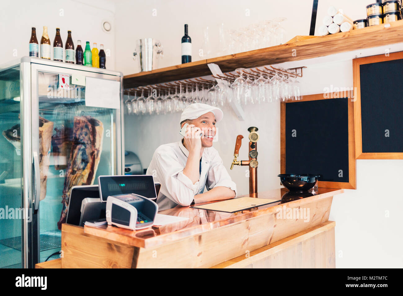 Butcher on phone in Sweden - Stock Image