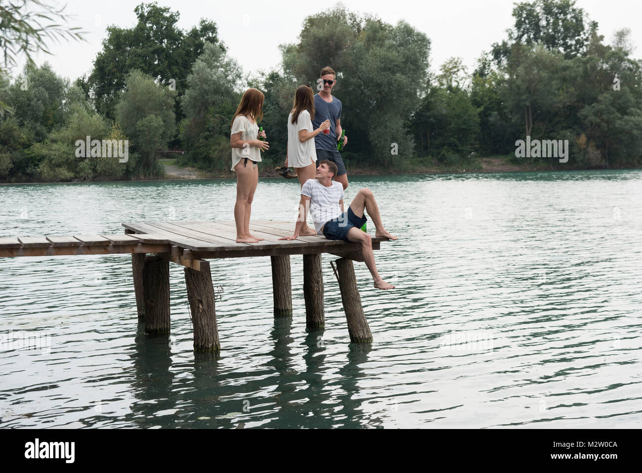 Youths on the quarry pond Liedolsheim, Dettenheim, Baden-Wurttemberg, Germany - Stock Image