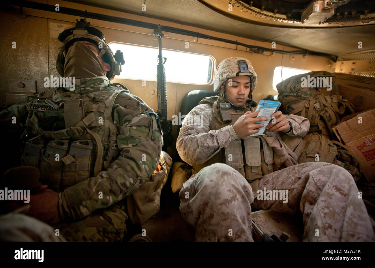 Petty Officer Third Class Michael Soto (right), the corpsman for Bridge Platoon, Alpha Company, 9th Engineer Support - Stock Image