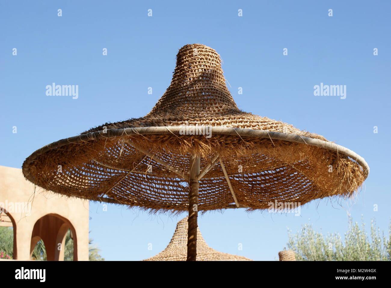 Straw umbrella sunshade, Tamerza, Tunisia - Stock Image