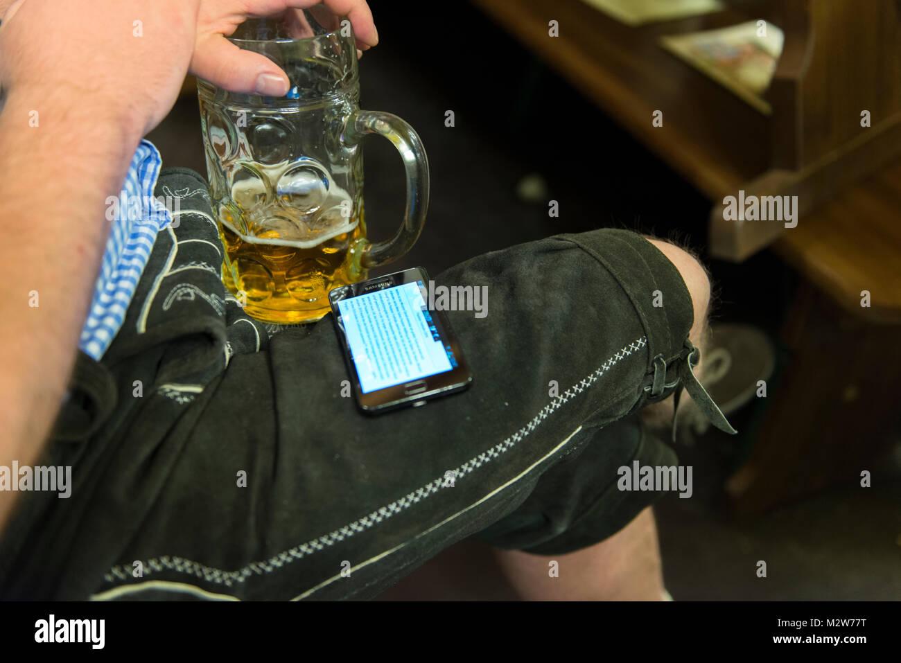 Beer mug and Lederhosen, Oktoberfest - Stock Image