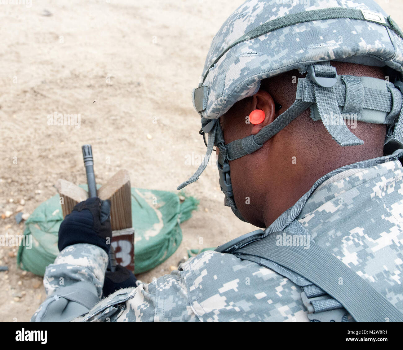 Sgt. Clarence Rankins, a member of the 316th ESC and native of York, Pa.,  adjusts the front sight of his M-16 Rifle - Stock Image