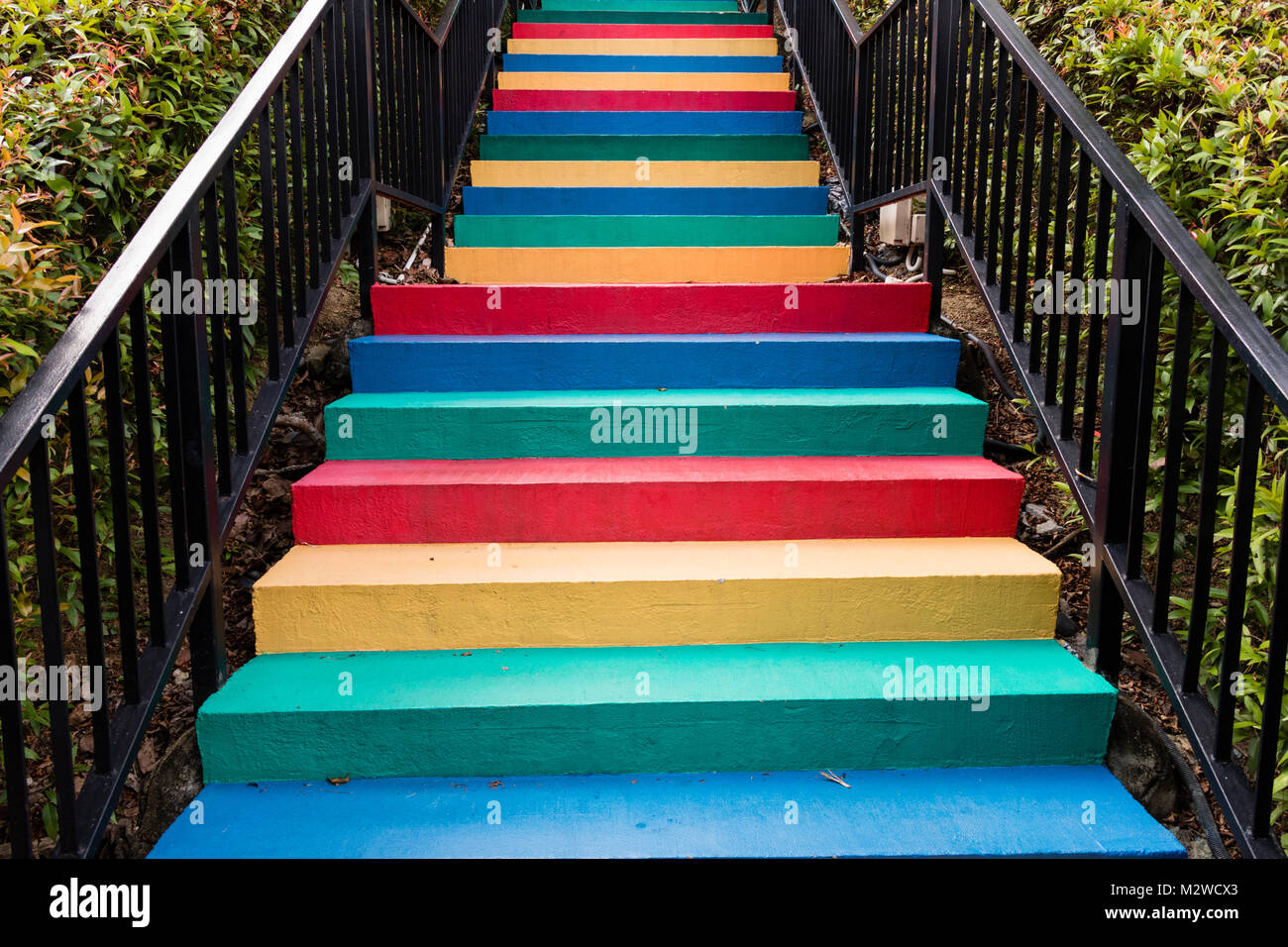 Stairs painted in rainbow colors background Stock Photo