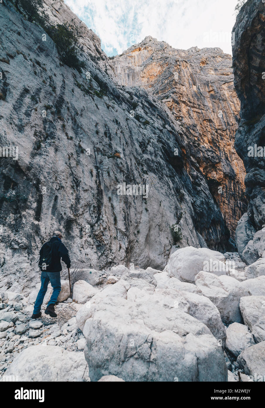 Aged Man hiking insdide the deepest canyon in Europe - Activity and Health concept - Gola Su Gorroppu. - Stock Image