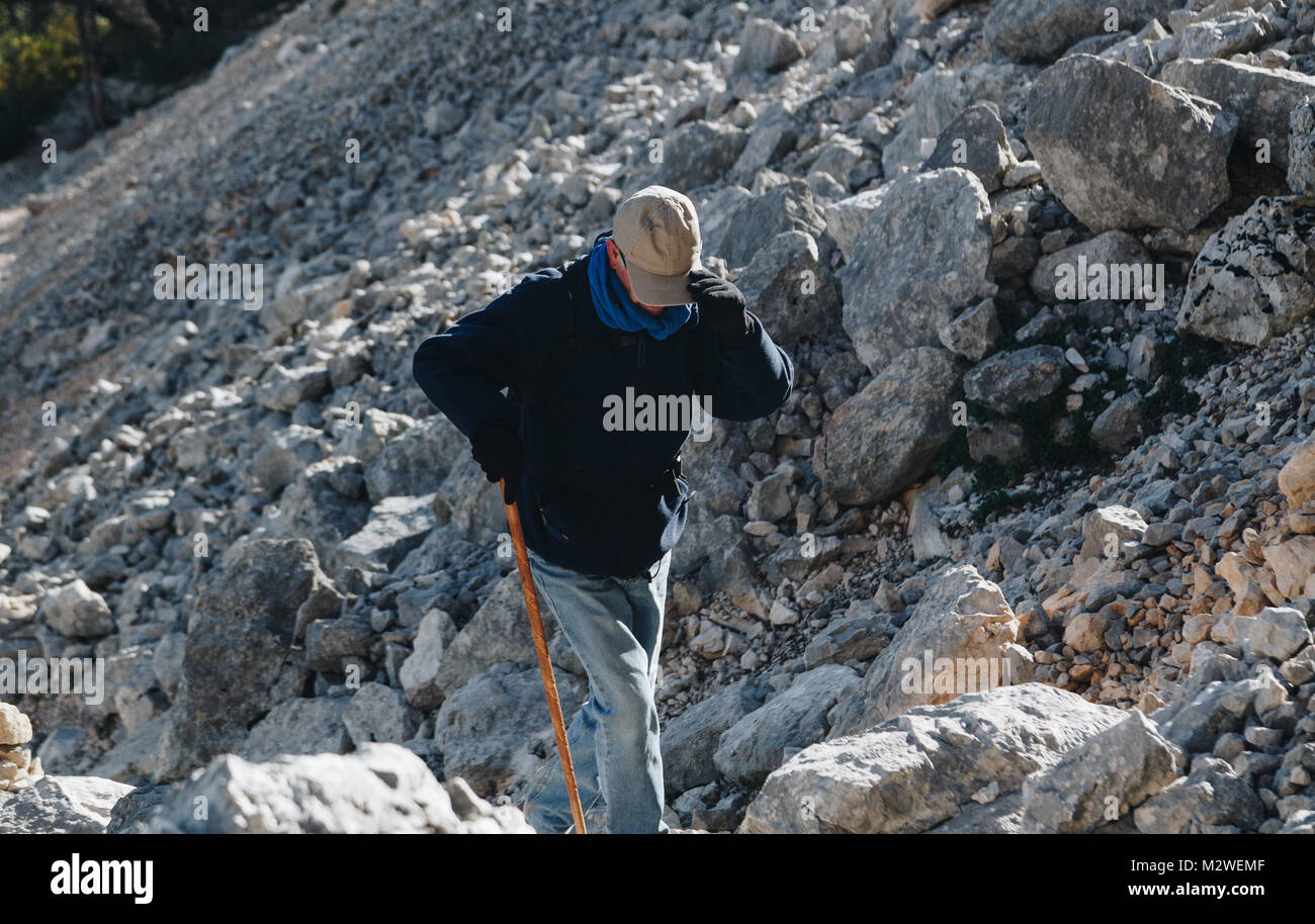 Aged man hiking in the trail to Gola su gorroppu - activity and health concept . - Stock Image