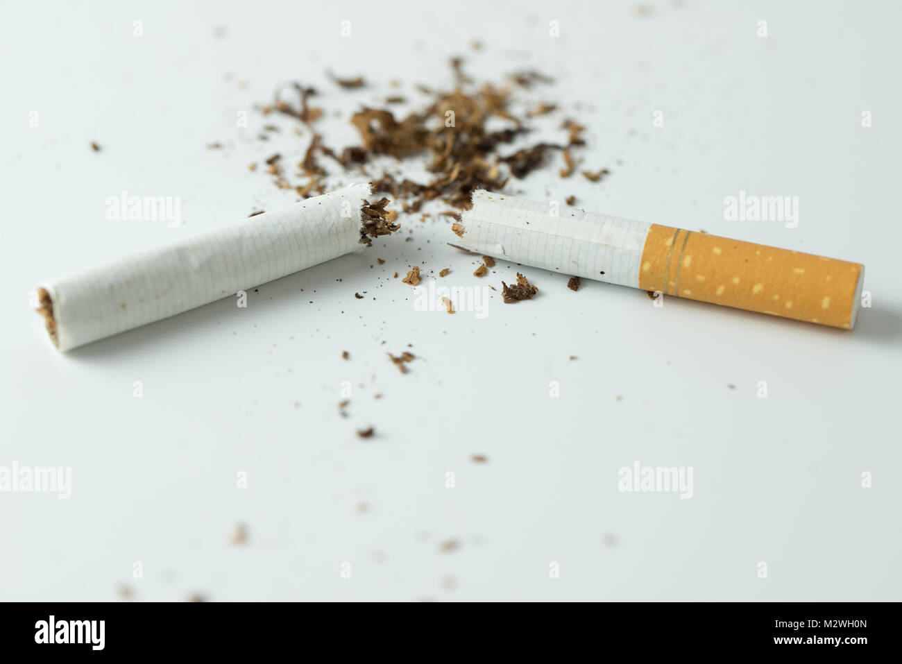 Quit smoking concept by breaking the cigarette - Stock Image