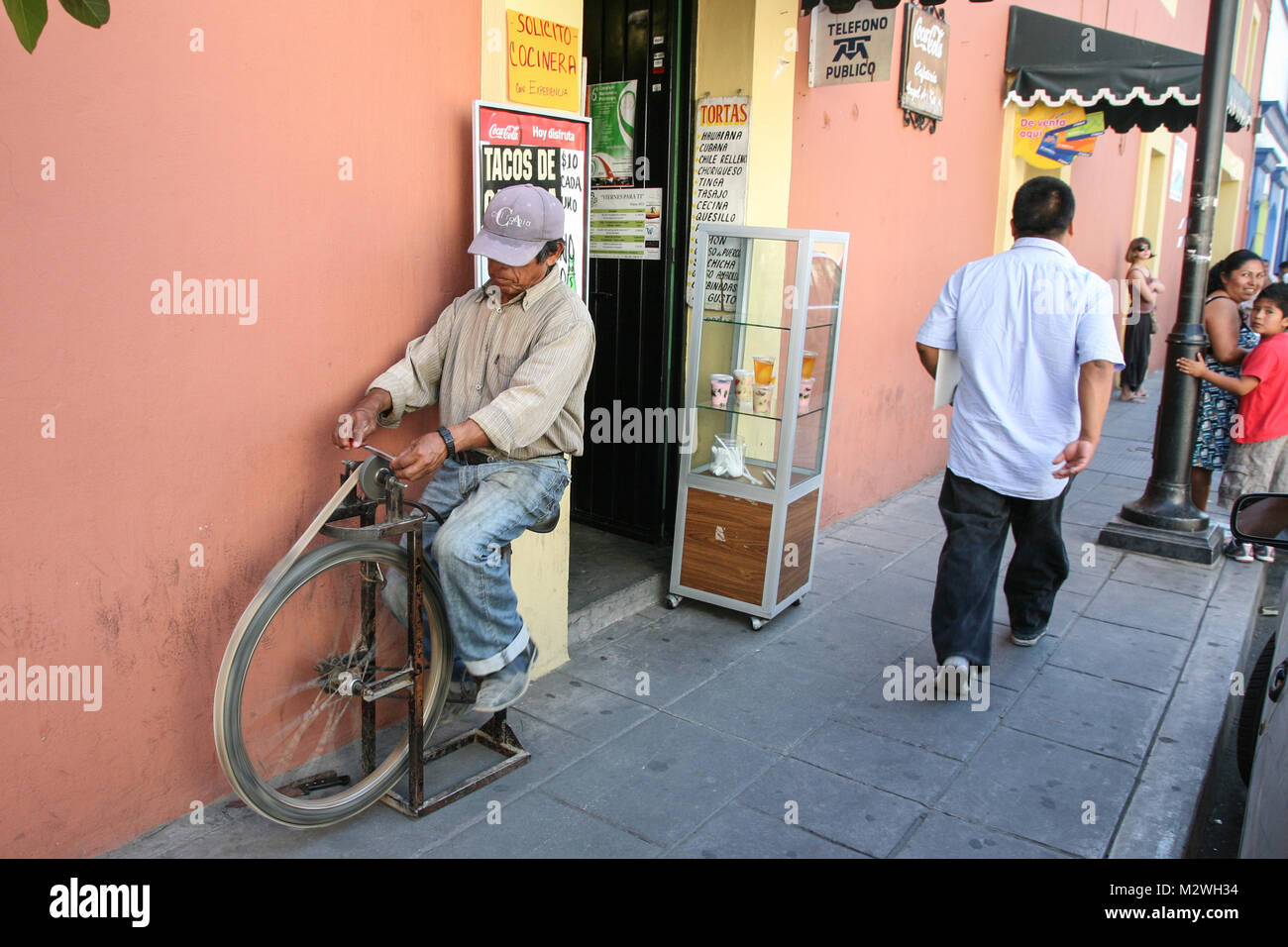 Oaxaca, Mexico - March 7th, 2012: Man grinding knives on a street in  Oaxaca, Mexico Stock Photo