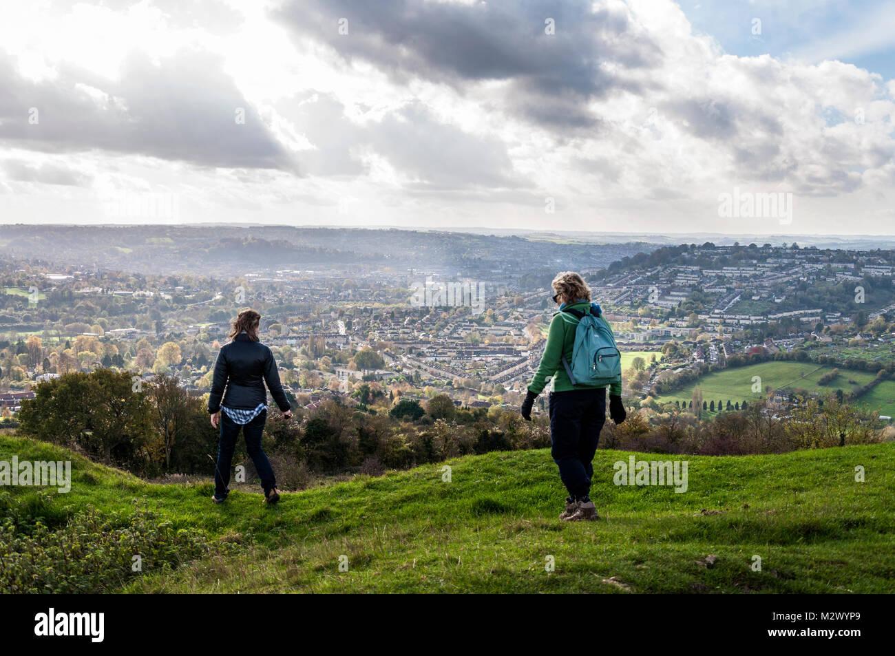 Walkers on Little Solsbury Hill, Batheaston, Bath, Somerset, England,UK Stock Photo