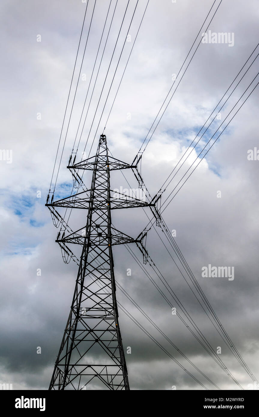 View of electricity pylon with graphic pattern of steel structure in England, UK - Stock Image