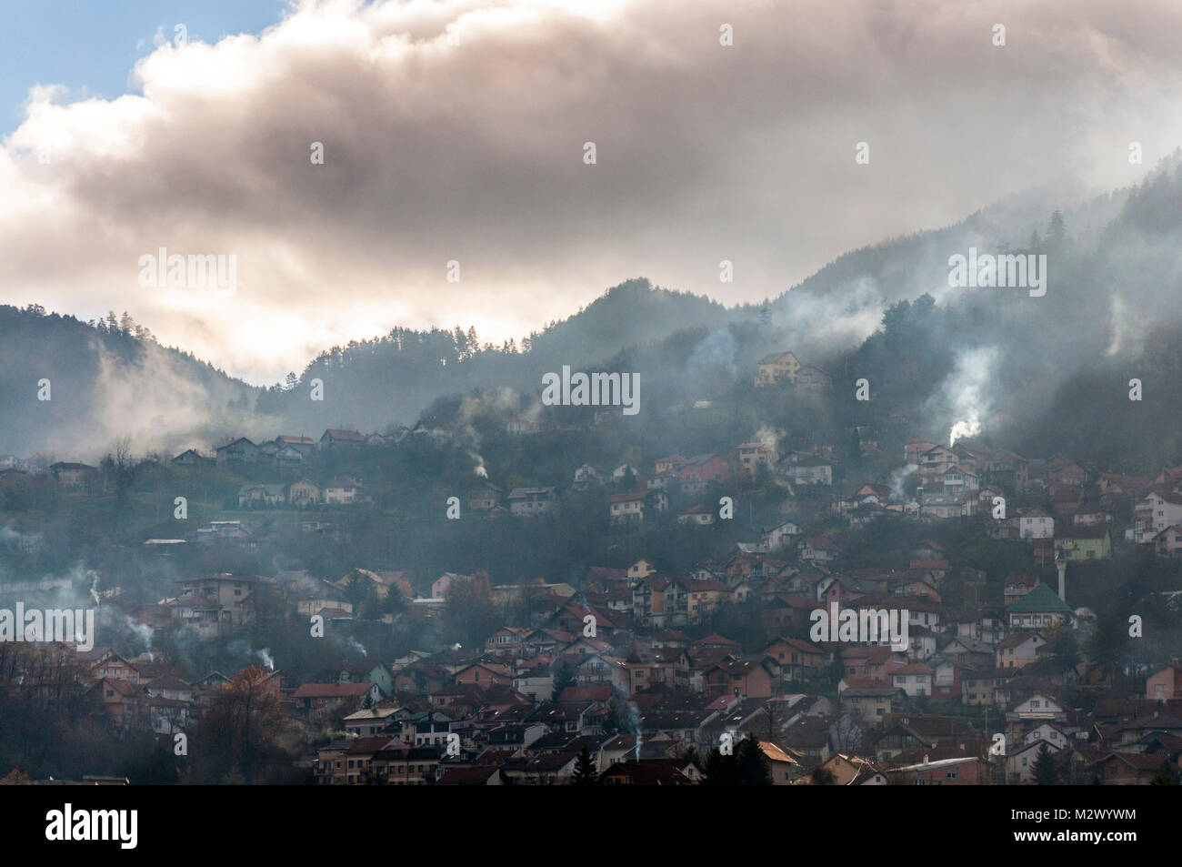 Early morning light in Sarajevo, Bosnia Hercegovina, Former Yugoslavia domestic fire smoke in surrounding hills - Stock Image