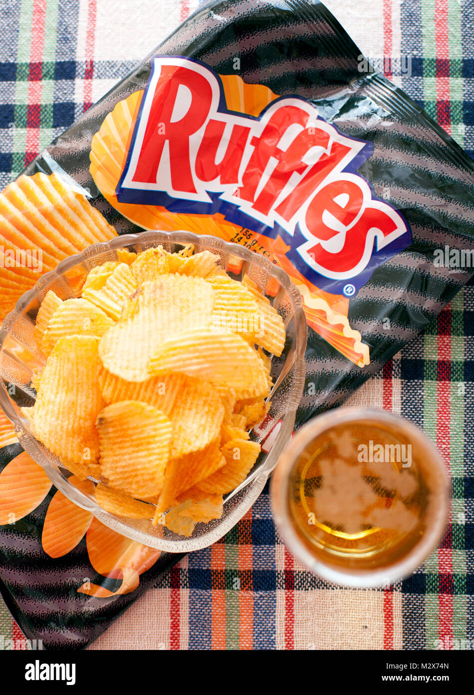 SOFIA, BULGARIA - May 11, 2015: 8.5 oz packet of RUFFLES brand cheddar and sour cream flavored potato chips - Stock Image