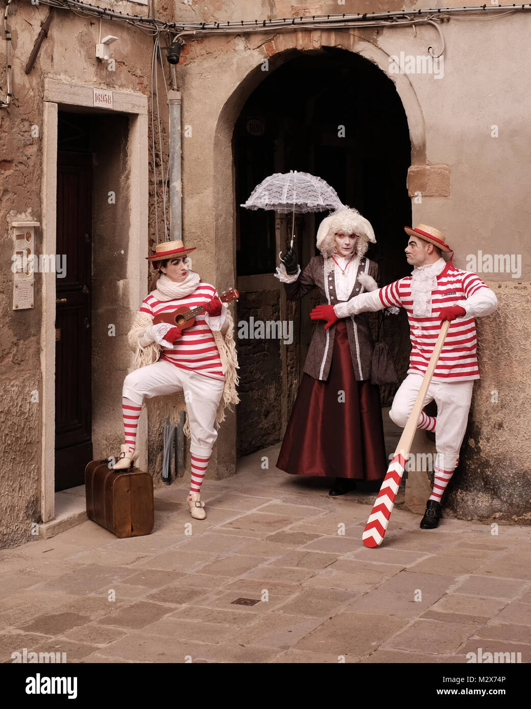 Street artists' performance in the street during the days of annual carnival - Stock Image