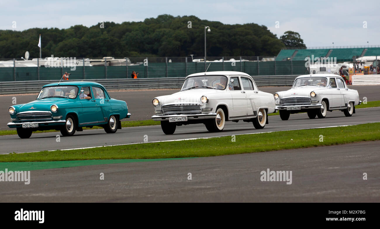 GAZ M21 Volga's parading around a historic race track during the 2017 Silverstone Classic - Stock Image