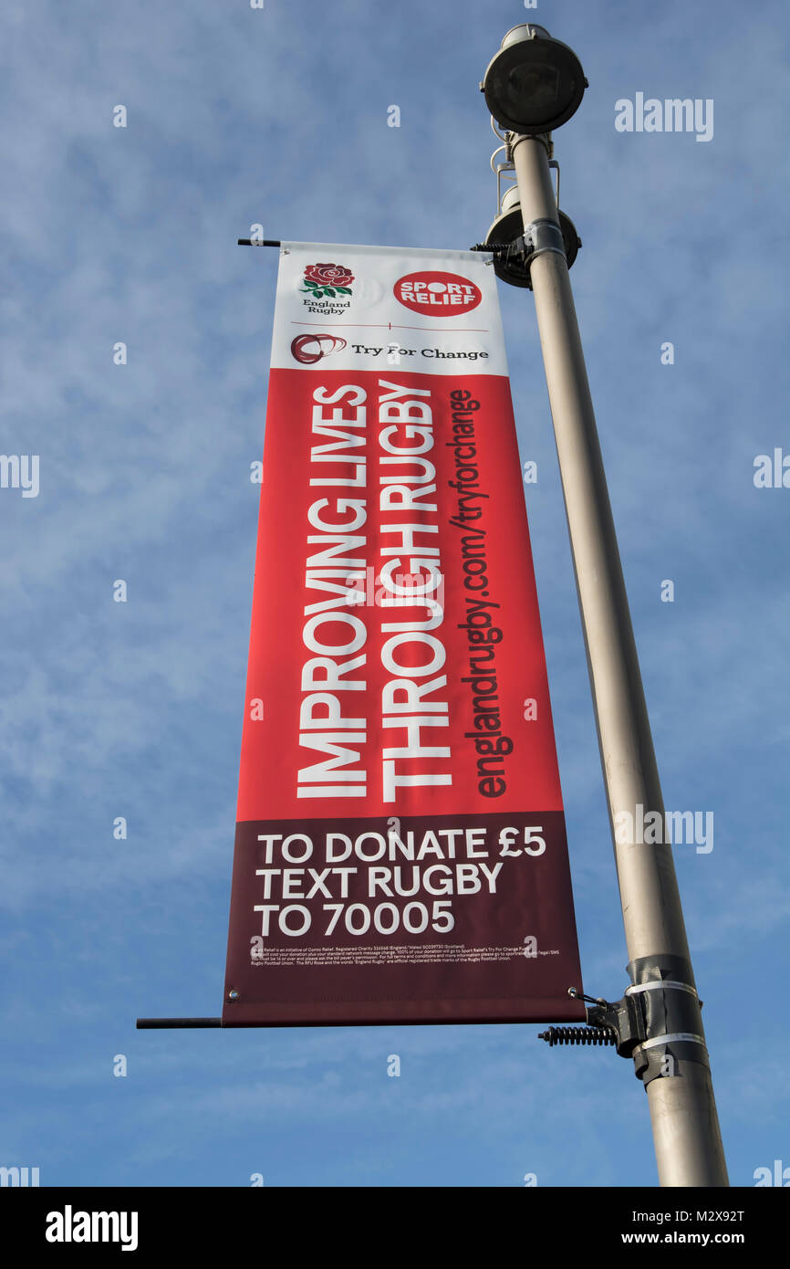 rugby themed try for change sport relief banner adverts outside twickenham stadium, home of the english rugby football - Stock Image
